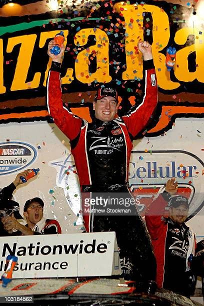 Kyle Busch, driver of the Z-Line Designs Toyota, celebrates in the winner's circle after winning the Nascar Nationawide Series U.S. Cellular 250 at...