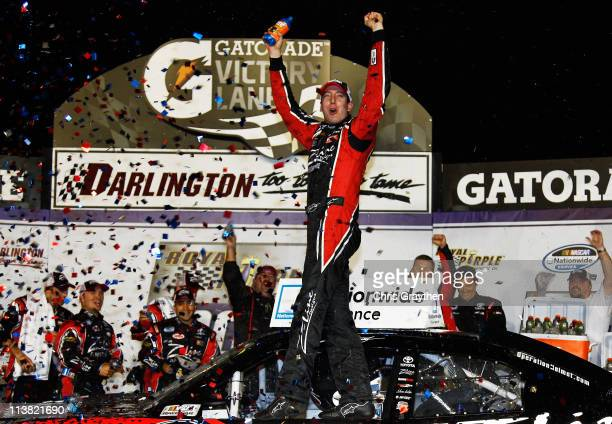Kyle Busch driver of the ZLine Designs Toyota celebrates in Victory Lane after winning the NASCAR Nationwide Series Royal Purple 200 at Darlington...