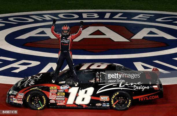 Kyle Busch driver of the ZLine Designs Toyota celebrates winning the NASCAR Nationwide Series Stater Bros 300 at Auto Club Speedway on February 21...