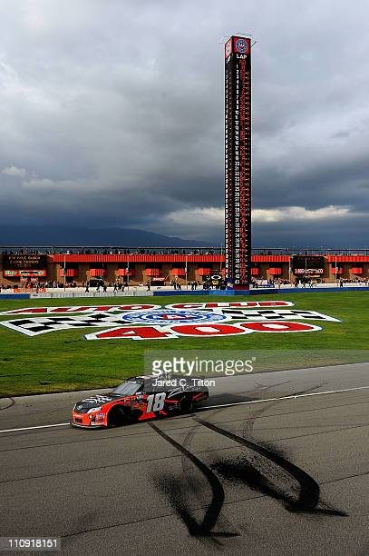 Kyle Busch driver of the ZLine Designs Toyota celebrates with the checkered flag after winning the NASCAR Nationwide Series Royal Purple 300 at Auto...
