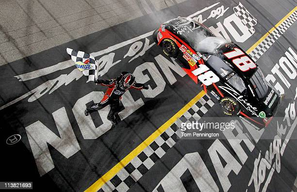 Kyle Busch driver of the ZLine Designs Toyota celebrates with the checkered flag after winning the NASCAR Nationwide Series Royal Purple 200 at...