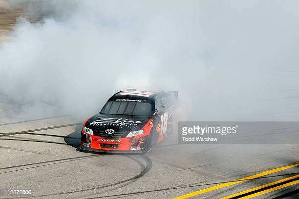 Kyle Busch driver of the ZLine Designs Toyota does a burnout after winning the NASCAR Nationwide Series Aaron's 312 at Talladega Superspeedway on...