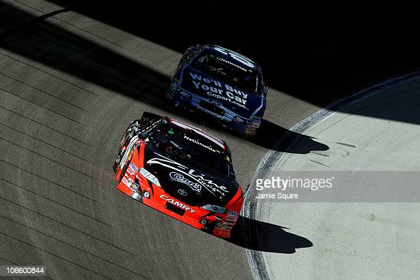 Kyle Busch driver of the ZLine Designs Toyota leads Carl Edwards driver of the Copartcom Ford during the NASCAR Nationwide Series O'Reilly Auto Parts...