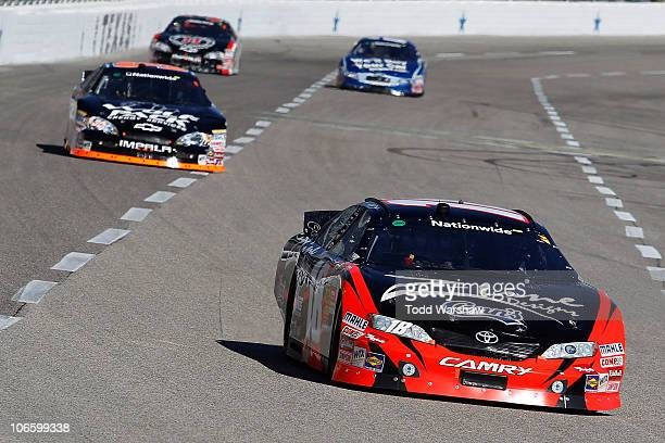 Kyle Busch driver of the ZLine Designs Toyota leads James Buescher driver of the Wolfpack Energy Services Chevrolet Kevin Harvick driver of the Jimmy...
