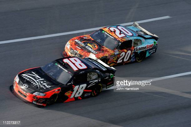 Kyle Busch driver of the ZLine Designs Toyota leads Joey Logano driver of the GameStop Toyota during the NASCAR Nationwide Series Aaron's 312 at...