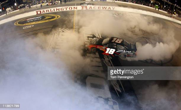 Kyle Busch driver of the ZLine Designs Toyota performs a burnout after winning the NASCAR Nationwide Series Royal Purple 200 at Darlington Raceway on...