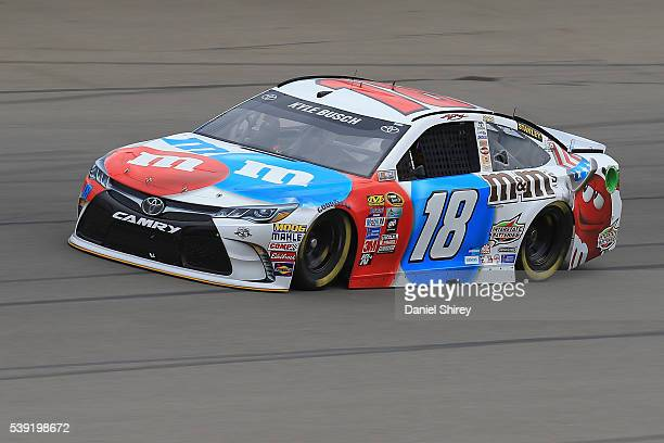 Kyle Busch drives the MM's RWB Toyota during practice for the NASCAR Sprint Cup Series FireKeepers Casino 400 at Michigan International Speedway on...