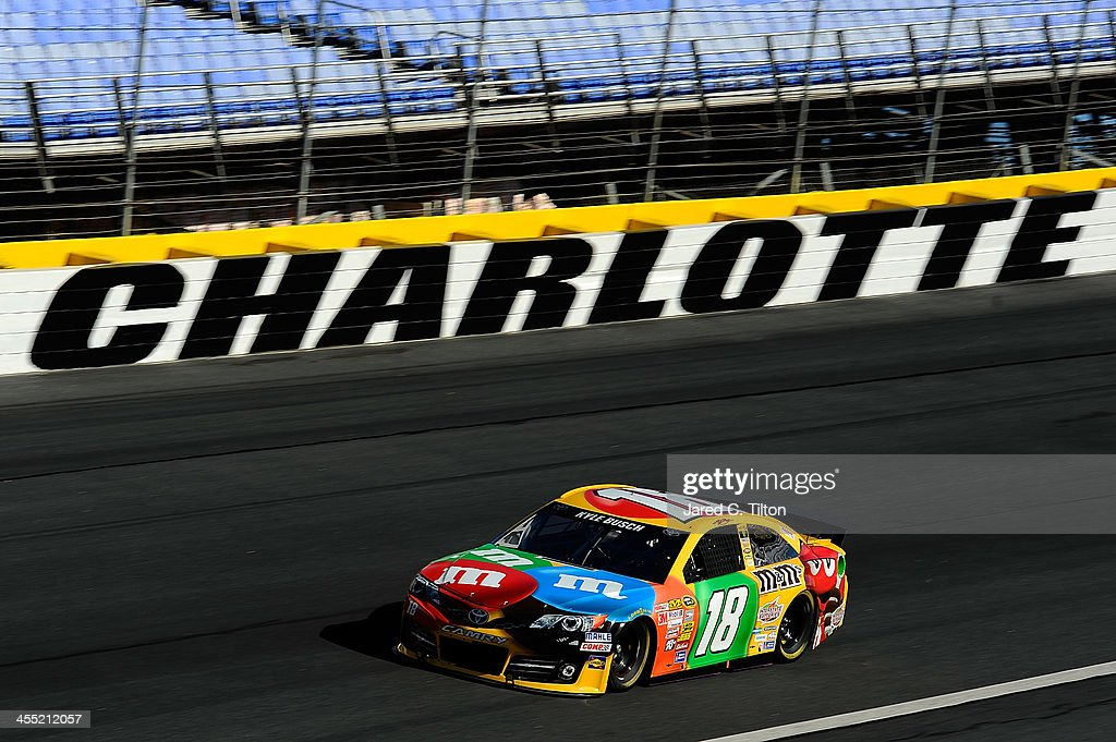 Kyle Busch drives the #18 M&M's Toyota during testing at Charlotte Motor Speedway on December 11, 2013 in Charlotte, North Carolina.