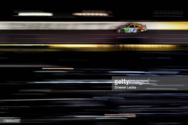 Kyle Busch drives the MM's Toyota during the NASCAR Sprint Cup Series Bank of America 500 at Charlotte Motor Speedway on October 15 2011 in Charlotte...