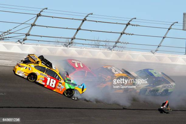 Kyle Busch Erik Jones Matt Kenseth and Ty Dillon crash in turn 3 during the NASCAR Monster Energy Cup Series Daytona 500 on February 26 at the...