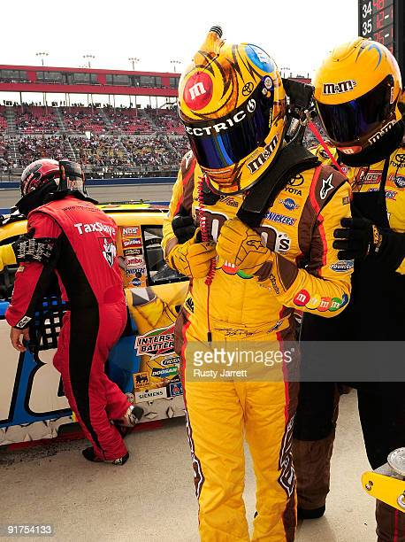 Kyle Busch is helped out of his car as David Gilliland waits take over the MM's Toyota during the NASCAR Sprint Cup Series Pepsi 500 at Auto Club...