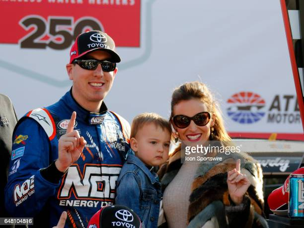Kyle Busch Joe Gibbs Racing NOS Energy Toyota Camry with son Brexton and wife Samantha celebrate winnng the Rinnai 250 at Atlanta Motor Speedway in...