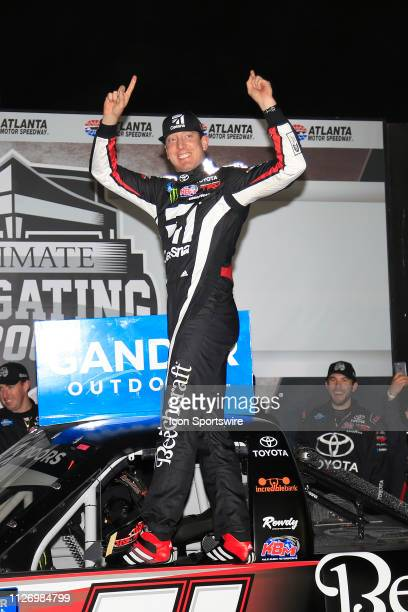 Kyle Busch KBM Toyota Tundra celebrates winning the 11th running of the Ultimate Tailgating 200 NASCAR Gander Outdoors Truck Series race on February...