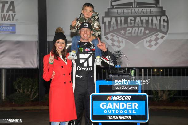 Kyle Busch KBM Toyota Tundra celebrates with his family after winning the 11th running of the Ultimate Tailgating 200 NASCAR Gander Outdoors Truck...