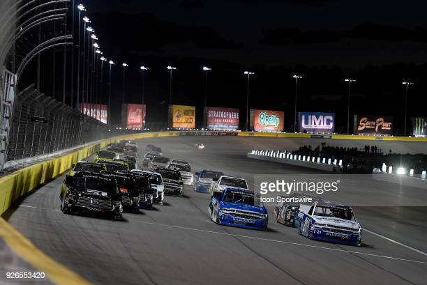 Kyle Busch KBM Toyota Tundra Stewart Friesen Chris Larsen Chevrolet Silverado and Johnny Sauter GMS Racing Chevrolet Silverado go three wide into...