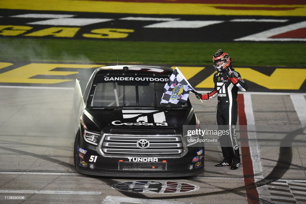 Kyle Busch KBM Toyota Tundra takes the Sunoco checkered flag