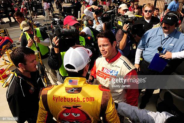 Kyle Busch talks with reporter Dave Burns after being relieved by David Gilliland in the MM's Toyota during the NASCAR Sprint Cup Series Pepsi 500 at...