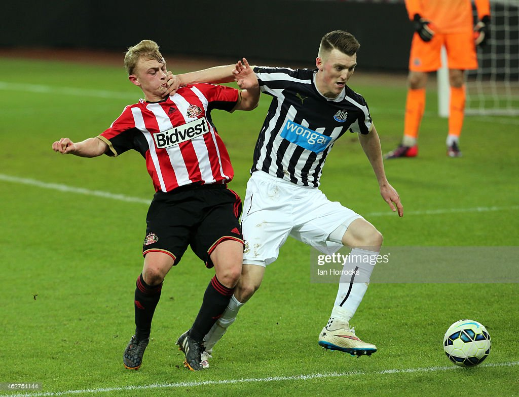 Kyle Cameron of Newcastle (R) holds off Daniel Wright of Sunderland (R) during the FA Youth Cup match between Sunderland U18 and Newcastle United U18 at The Stadium of Light on February 04, 2015 in Sunderland, England.