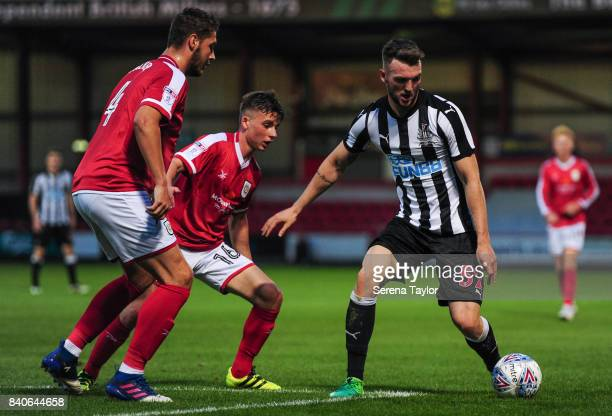 Kyle Cameron of Newcastle United controls the ball while being closed down by Brad Walker and Tommy Lowery of Crewe Alexandra during the Checkatrade...
