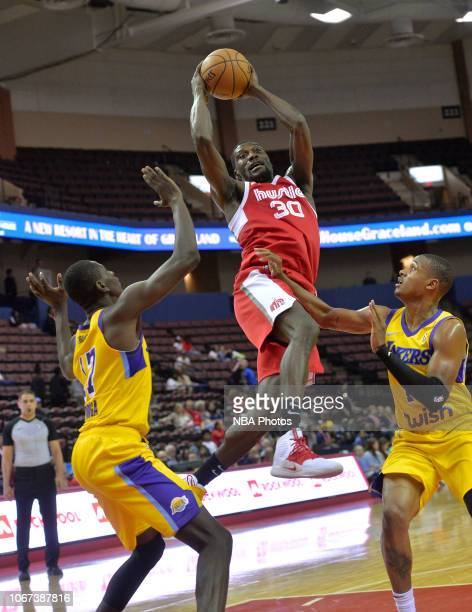 Kyle Casey of the Memphis Hustle grabs a rebound between Isaac Bonga and Demarcus Holland of the South Bay Lakers during an NBA GLeague game on...