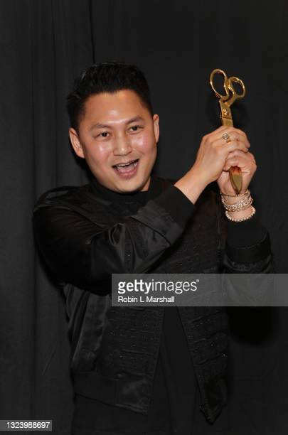 Kyle Chan cuts the ribbon at his store opening at Kyle Chan Design on June 16, 2021 in Los Angeles, California.