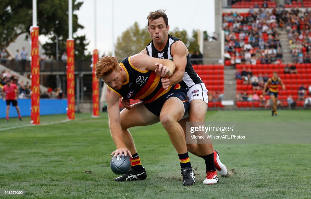 Kyle Cheney of the Crows and Jarryd Blair of the Magpies in action during the AFLX match between the Adelaide Crows and the Collingwood Magpies at Hindmarsh Stadium on February 15, 2018 in Adelaide, Australia.