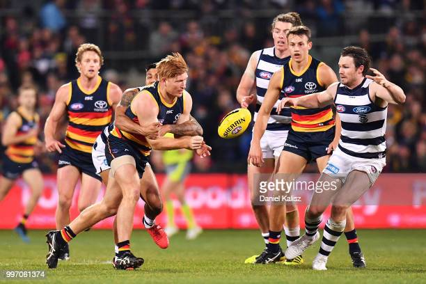 Kyle Cheney of the Crows handballs during the round 17 AFL match between the Adelaide Crows and the Geelong Cats at Adelaide Oval on July 12 2018 in...