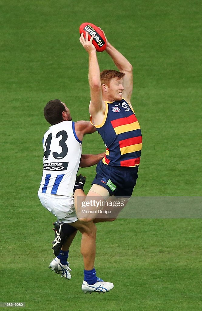Kyle Cheney of the Crows marks the ball against Sam Gibson of the Kangaroos during the round one AFL match between the Adelaide Crows and the North Melbourne Kangaroos at Adelaide Oval on April 5, 2015 in Adelaide, Australia.