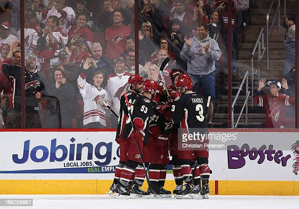 Kyle Chipchura Derek Morris Andy Miele and Keith Yandle of the Phoenix Coyotes celebrate after Morris scored a second period goal against the Los...