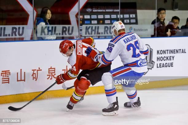 Kyle Chipchura of HC Kunlun Red Star and Ilya Kablukov of SKA Saint Petersburg vie for the puck during the 2017/18 Kontinental Hockey League Regular...