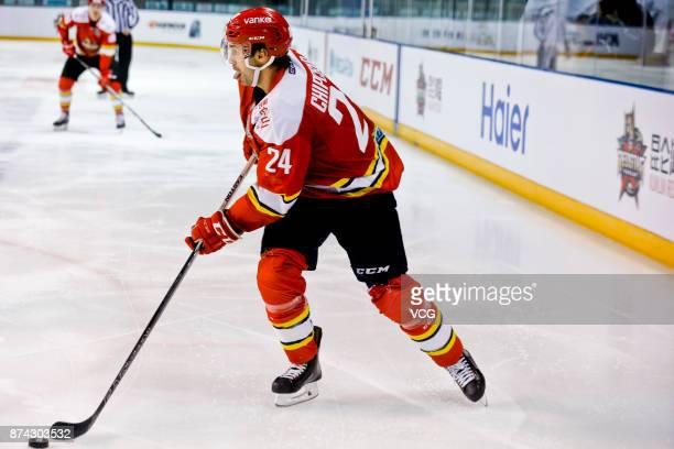 Kyle Chipchura of HC Kunlun Red Star hits the puck during the 2017/18 Kontinental Hockey League Regular Season match between HC Kunlun Red Star and...