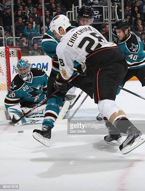 Kyle Chipchura of the Anaheim Ducks shoots the puck toward Evgeni Nabokov of the San Jose Sharks and past Patrick Marleau and Kent Huskins during an...