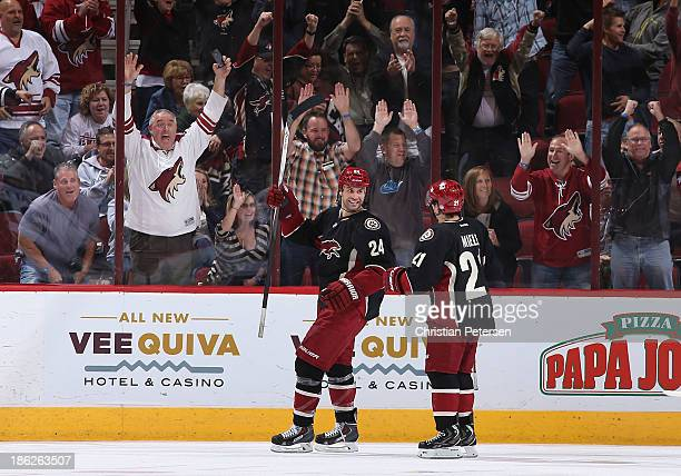 Kyle Chipchura of the Phoenix Coyotes celebrates with Andy Miele after scoring a third period goal against the Los Angeles Kings during the NHL game...