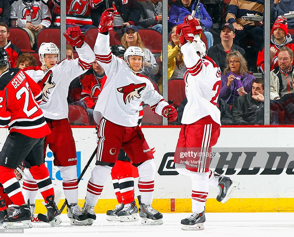 Kyle Chipchura #24 of the Phoenix Coyotes celebrates with his teammates after scoring a first period goal against the New Jersey Devils at the Prudential Center on March 27, 2014 in Newark, New Jersey.