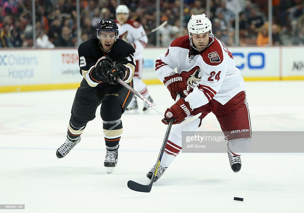 Kyle Chipchura #24 of the Phoenix Coyotes is pursued by Nick Bonino #13 of the Anaheim Ducks for the puck in the first period at Honda Center on March 6, 2013 in Anaheim, California. The Ducks defeated the Coyotes 2-0.