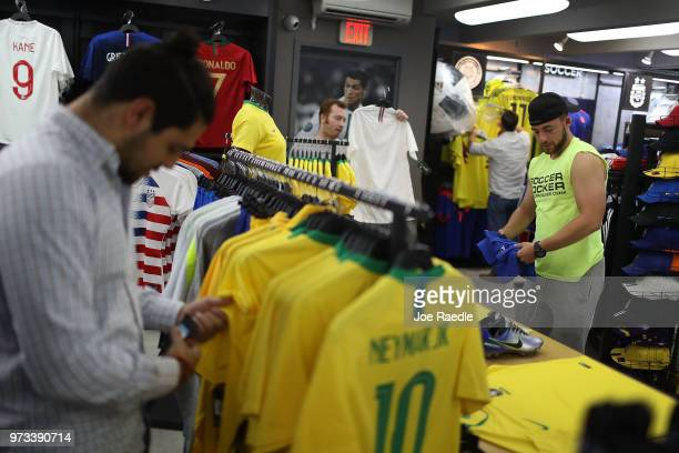 Kyle Cividanes and other customers shop at the Soccer Locker store for jerseys to wear during the World Cup soccer tournament being held in Russia on...