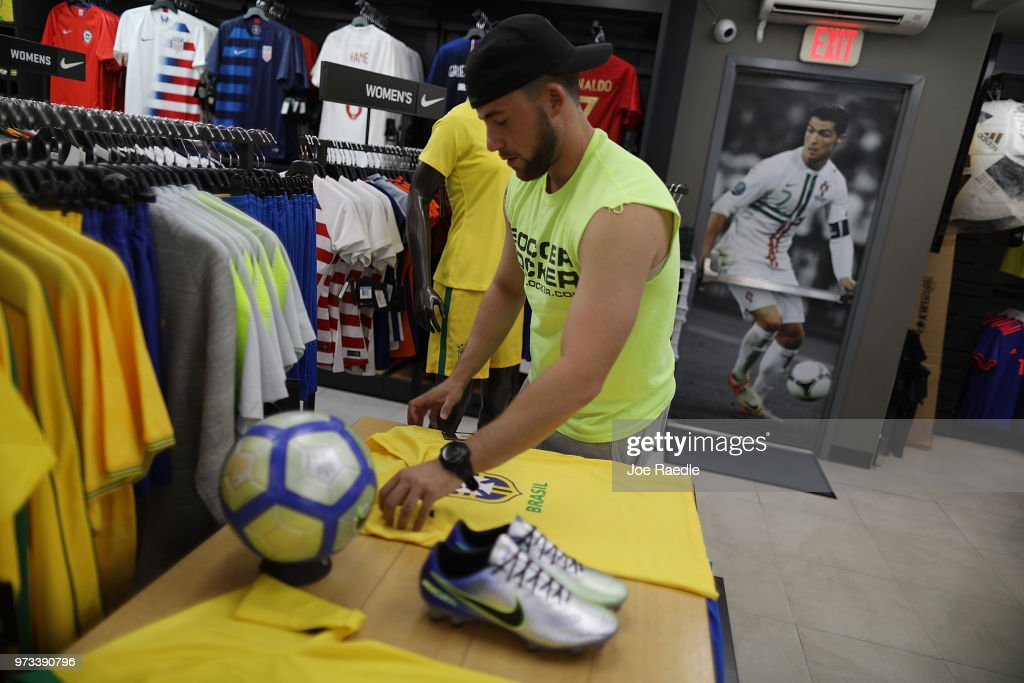 Kyle Cividanes shops at the Soccer Locker store for Brazilian soccer team items as he prepares to show his support for the team as it plays in the World Cup soccer tournament being held in Russia on June 13, 2018 in Miami, Florida. As the world prepares for the kickoff of the World Cup soccer tournament tomorrow, FIFA announced today that North America will host the tournament in 2026.