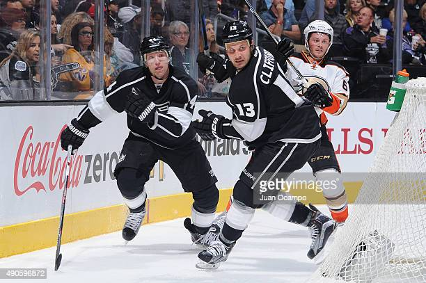 Kyle Clifford and Christian Ehrhoff of the Los Angeles Kings skate against Chris Wagner of the Anaheim Ducks at STAPLES Center on September 29 2015...