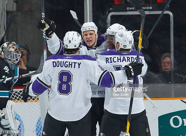 Kyle Clifford, Drew Doughty, Wayne Simmonds and Brad Richardson of the Los Angeles Kings celebrate a first-period goal against Antti Niemi of the San...