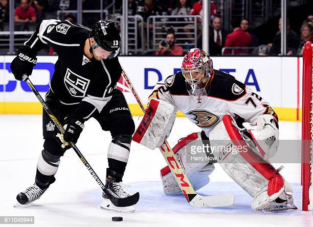 Kyle Clifford of the Los Angeles Kings attempts a move on Yann Danis of the Anaheim Ducks during a preseason game at Staples Center on September 28...