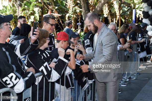 Kyle Clifford of the Los Angeles Kings autographs jerseys before the Los Angeles Kings game against the Nashville Predators at STAPLES Center on...