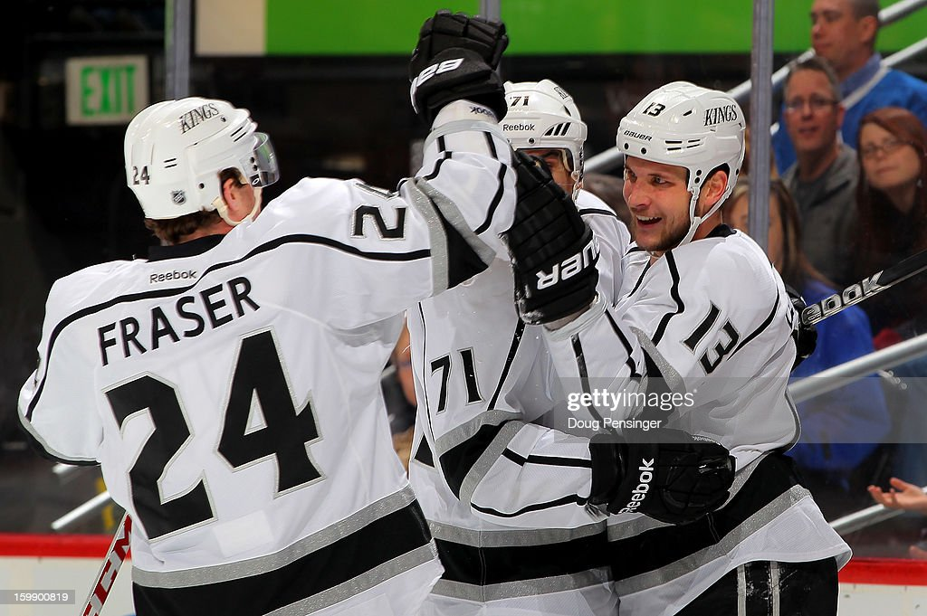 Kyle Clifford #13 of the Los Angeles Kings celebrates his goal in the first period against the Colorado Avalanche with teammates Jordan Nolan #71 and Colin Fraser #24 of the Los Angeles Kings at the Pepsi Center on January 22, 2013 in Denver, Colorado.