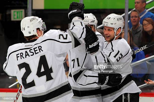 Kyle Clifford of the Los Angeles Kings celebrates his goal in the first period against the Colorado Avalanche with teammates Jordan Nolan and Colin...