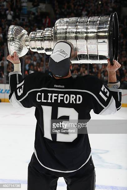 Kyle Clifford of the Los Angeles Kings celebrates with the Stanley Cup after the Kings won Game Five 32 in double overtime over the New York Rangers...