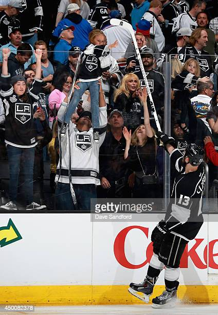 Kyle Clifford of the Los Angeles Kings gives away his stick after the Kings won Game One of the 2014 Stanley Cup Final over the New York Rangers at...