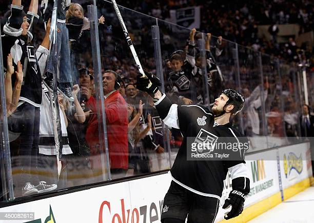 Kyle Clifford of the Los Angeles Kings gives away his stick after the Kings won Game One of the 2014 Stanley Cup Final over the New York Rangers in...