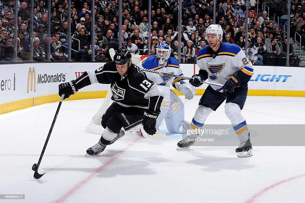 Kyle Clifford #13 of the Los Angeles Kings handles the puck during a game against the St. Louis Blues at STAPLES Center on December 18, 2014 in Los Angeles, California.