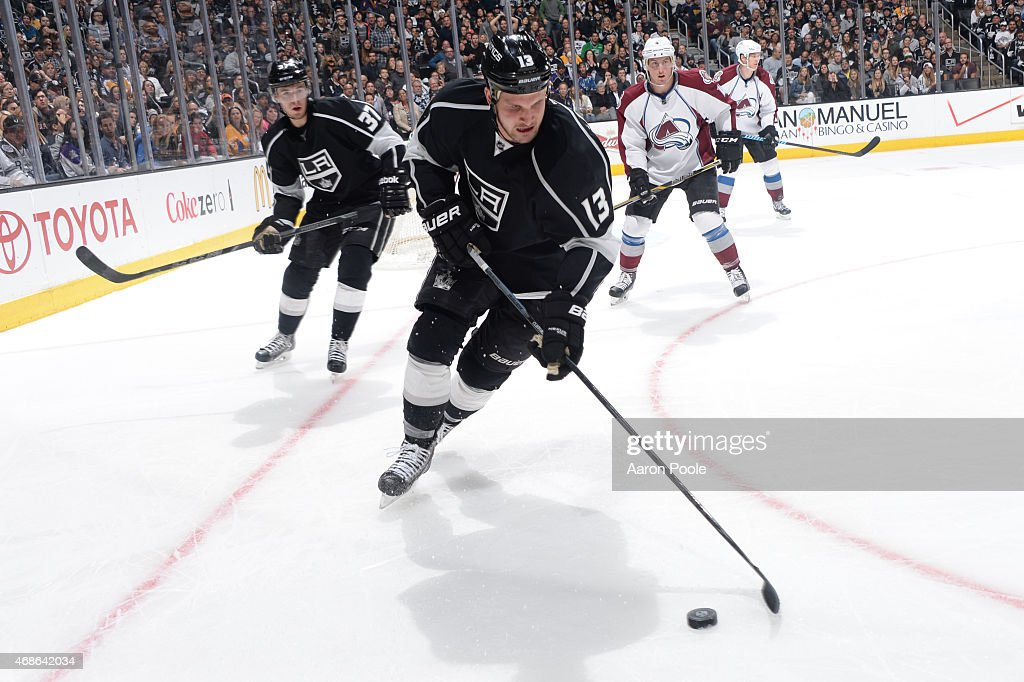 Kyle Clifford #13 of the Los Angeles Kings handles the puck during a game against the Colorado Avalanche at STAPLES Center on April 4, 2015 in Los Angeles, California.