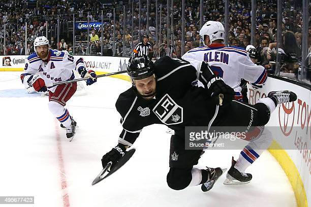 Kyle Clifford of the Los Angeles Kings is checked by Kevin Klein of the New York Rangers in the second period during Game One of the 2014 NHL Stanley...