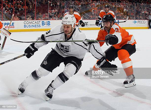 Kyle Clifford of the Los Angeles Kings is checked by Radko Gudas of the Philadelphia Flyers during the first period at the Wells Fargo Center on...